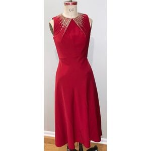 Red midi length dress with neck beading